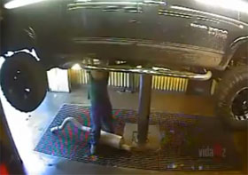 Video: Dodge Ram Falls Off Lift