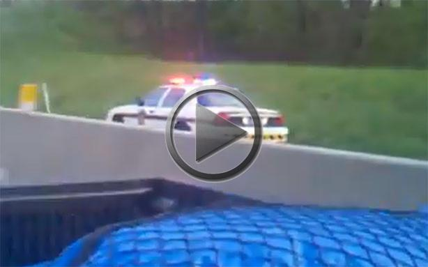 Police Car Drives Backwards Into Incoming Highway Traffic