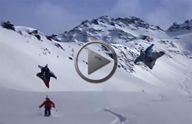 Wingsuit Flying Over Skiers